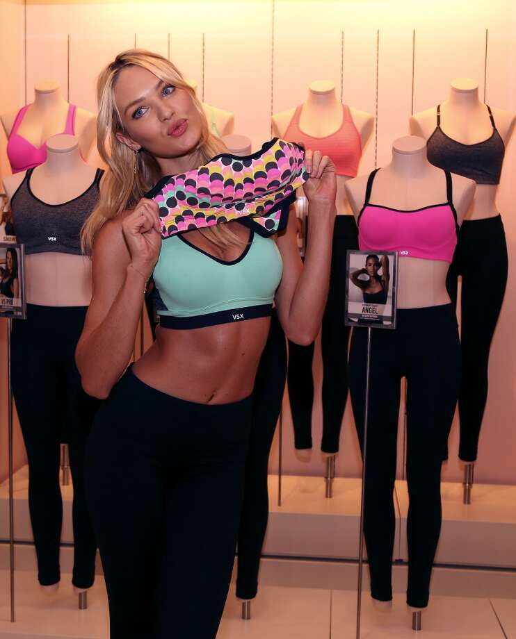 "Victoria's Secret model Candice Swanepoel models the ""Incredible"" sports bra at the Victoria's Secret store in the Galleria. Photo: Karen Warren, Houston Chronicle"