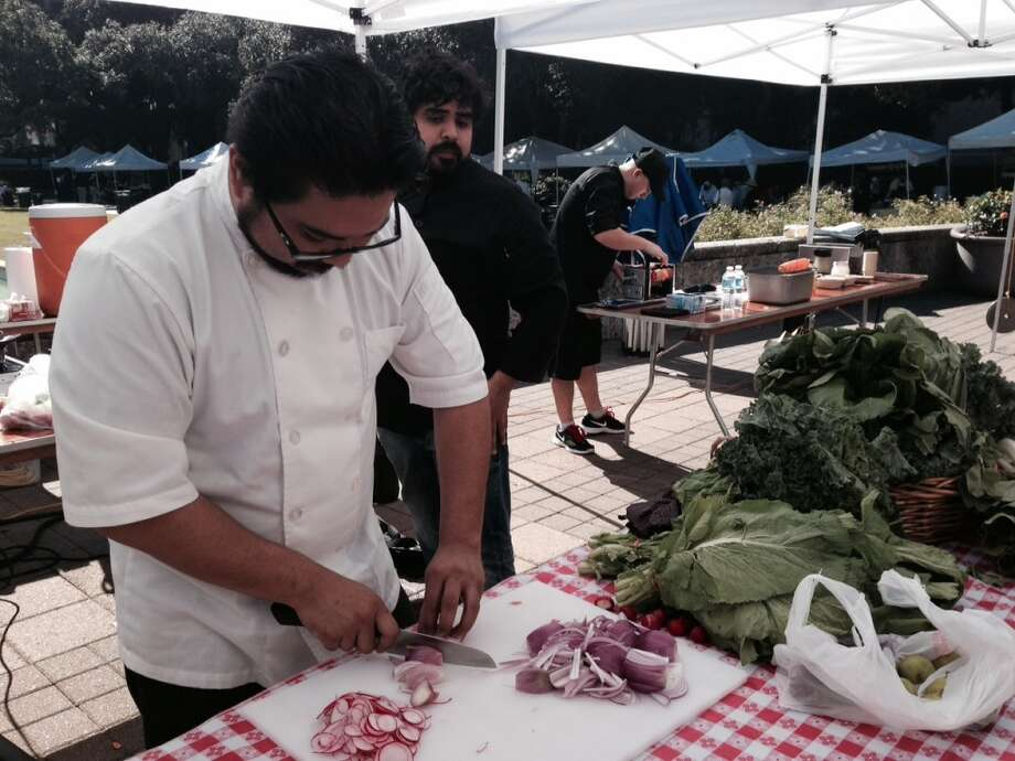 Chef Rob Frias of Gladstone Taverns preps ingredients for his dish. Photo: Diane Cowen, Houston Chronicle