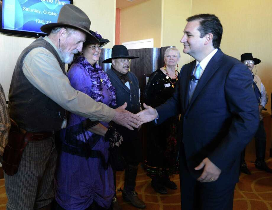 Sen. Ted Cruz greets members of the Badland Texas Rangers at the recent Texas Federation of Republican Women State Convention in San Antonio. The government shutdown is over, but readers continue to weigh in on his role in it. Photo: Billy Calzada / San Antonio Express-News