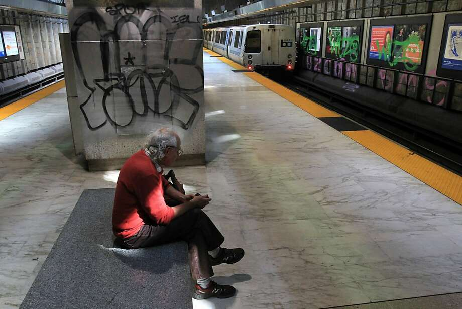Paul Bloom awaits a train in San Francisco's graffiti-covered Glen Park BART Station, which was defaced during the strike. Photo: Leah Millis, The Chronicle