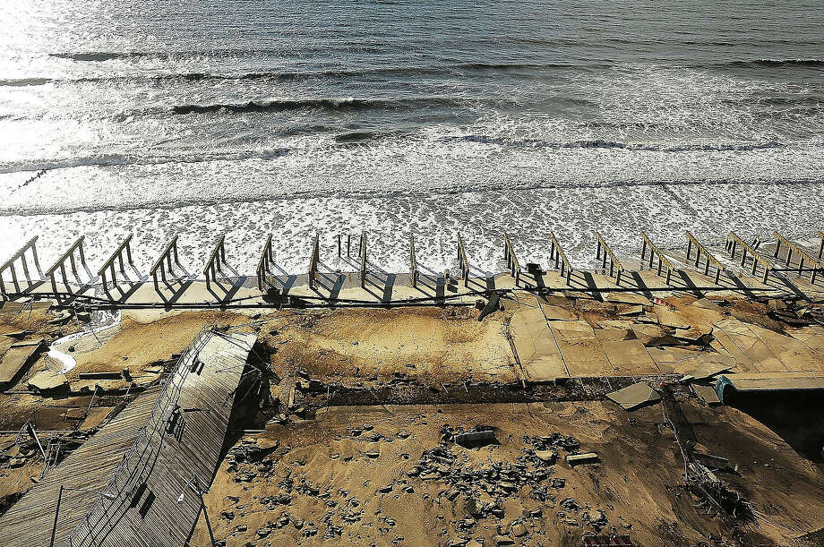 The foundations to the historic Rockaway boardwalk are all that remain after it was washed away during Hurricane Sandy on October 31, 2012 in the Rockaway neighborhood of the Queens borough of New York City. Photo: Spencer Platt, Getty Images / 2013 Getty Images