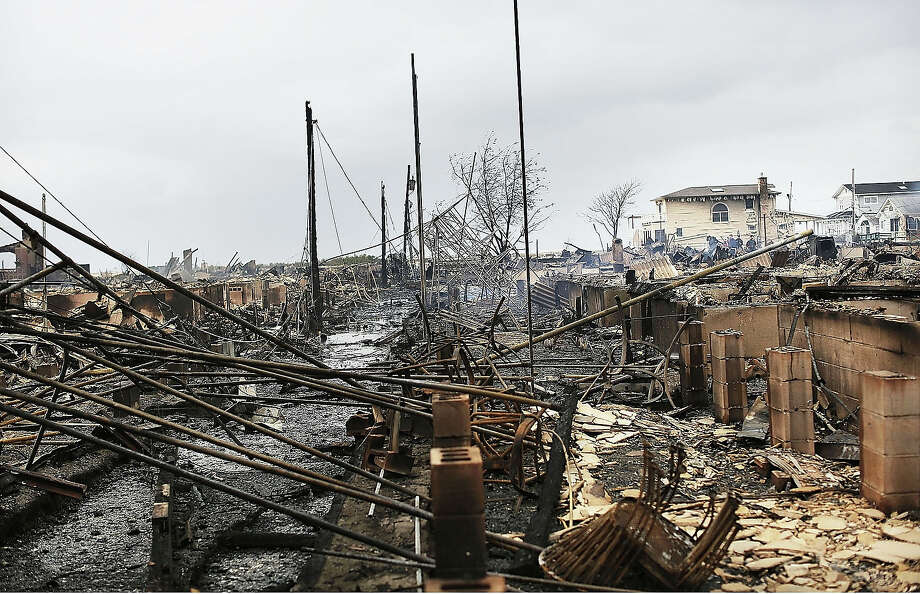 Homes sit destroyed after Hurricane Sandy on October 30, 2012 in the Breezy Point neighborhood of the Queens borough of New York City. Photo: Spencer Platt, Getty Images / 2013 Getty Images
