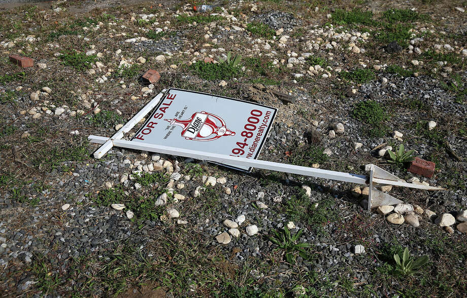 "A ""for sale"" sign lies on an empty lot where Joseph Bono's home was demolished due to Hurricane Sandy flood damage on October 17, 2013 in the Ocean Breeze neighborhood of the Staten Island borough of New York City. Hurricane Sandy made landfall on October 29, 2012 near Brigantine, New Jersey and affected 24 states from Florida to Maine and cost the country an estimated $65 billion. Photo: John Moore, Getty Images / 2013 Getty Images"