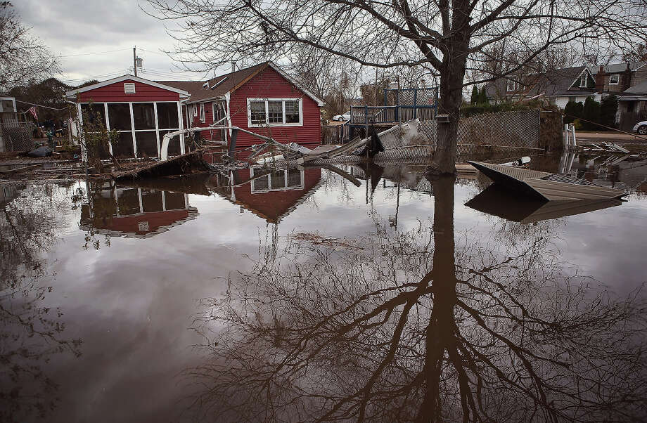Water continues to flood a neighborhood on November 1, 2012 in the Ocean Breeze area of the Staten Island borough of New York City. Most homes in the seaside community were inundated by the ocean surge caused by Superstorm Sandy. Photo: John Moore, Getty Images / 2013 Getty Images