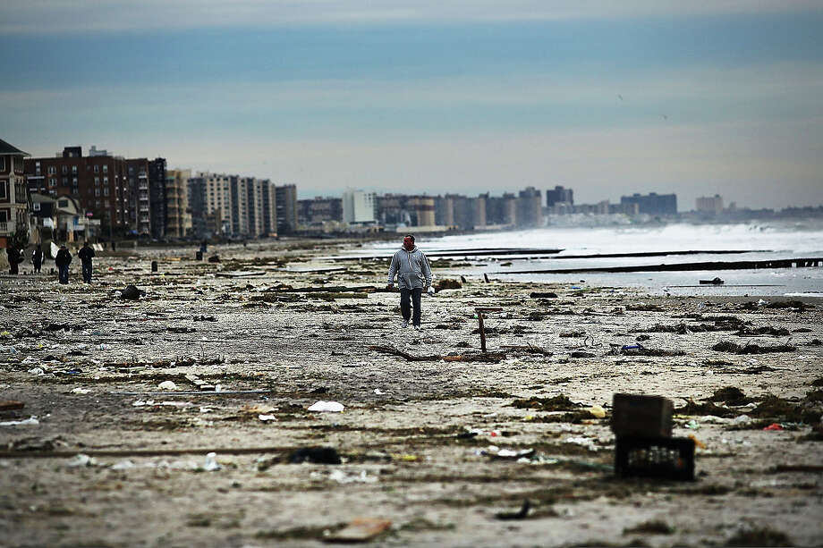 A man walks along the heavily damaged beach on November 2, 2012 in Rockaway neighborhood of the Queens borough of New York City. Photo: Spencer Platt, Getty Images / 2013 Getty Images