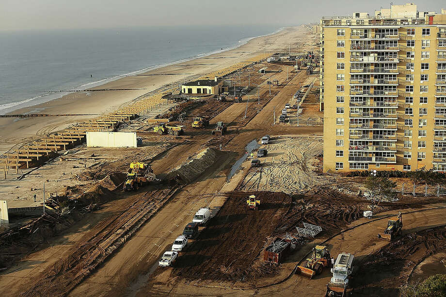 Clean-up continues amongst piles of debris where a large section of the iconic boardwalk was washed away on November 10, 2012 in the Rockaway neighborhood of the Queens borough of New York City. Photo: Spencer Platt, Getty Images / 2013 Getty Images