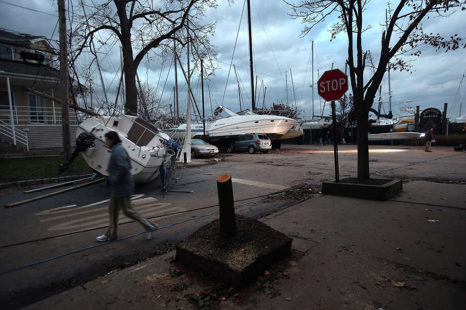 Boats pushed up by Hurricane Sandy lie against residences near a marina on November 2, 2012 in the Staten Island borough of New York City. Photo: John Moore, Getty Images / 2013 Getty Images
