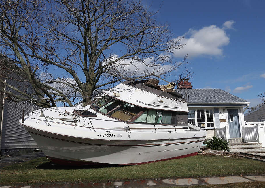 In the aftermath of Hurricane Sandy, boats continue to litter the landscape on Grant Street on November 2, 2012 in Freeport, New York. Photo: Bruce Bennett, Getty Images / 2013 Getty Images