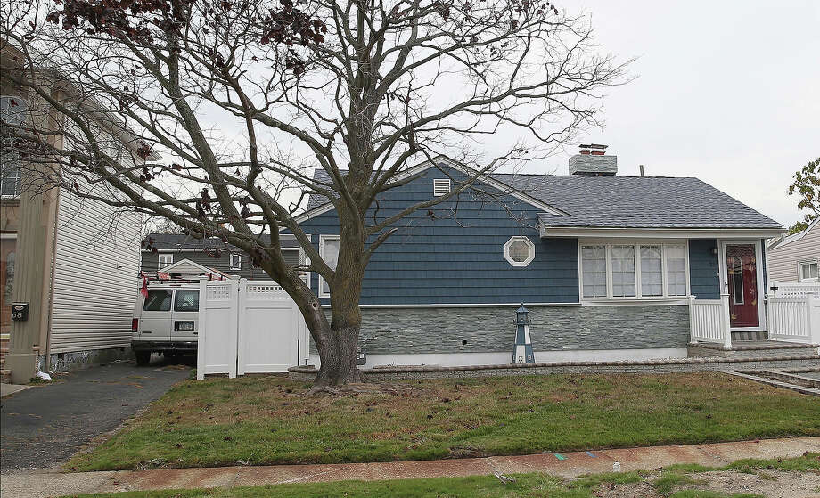 A home that had sustained damage during Superstorm Sandy sits on Grant Street on October 22, 2013 in Freeport, New York. Hurricane Sandy made landfall on October 29, 2012 near Brigantine, New Jersey and affected 24 states from Florida to Maine and cost the country an estimated $65 billion. Photo: Bruce Bennett, Getty Images / 2013 Getty Images