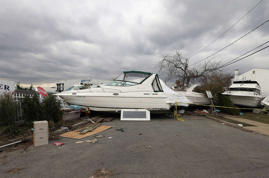 A boat from the Blue Water Club blocks Whaleneck Drive in the aftermath of Superstorm Sandy on November 1, 2012 in Merrick, New York. Superstorm Sandy, which has left millions without power or water, continues to effect business and daily life throughout much of the eastern seaboard. Photo: Bruce Bennett, Getty Images / 2013 Getty Images