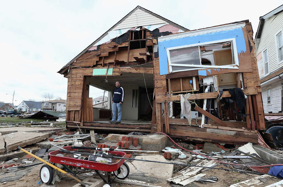 Gary Silberman surveys his home that was destroyed by Hurricane Sandy on October 31, 2012 in Lindenhurst, New York, United States. Photo: Bruce Bennett, Getty Images / 2013 Getty Images