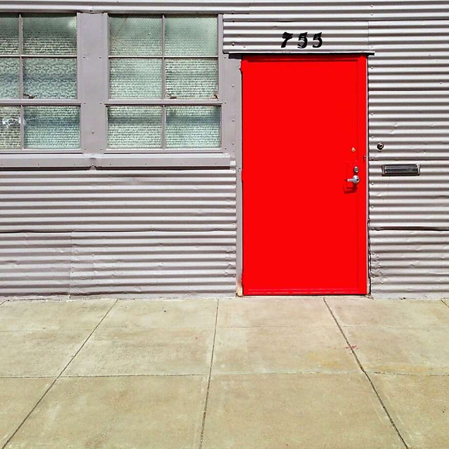 "From photographer Julie Gebhardt, ""I like to roam the city, shooting with an eye for color and detail. San Francisco has such a rich variety of doors and windows, my favorite subject. This vibrant red door was discovered on a quiet street in the Dogpatch neighborhood.  Follow her on Instagram - @juliegeb. Photo: Julie Gebhardt, @juliegeb"