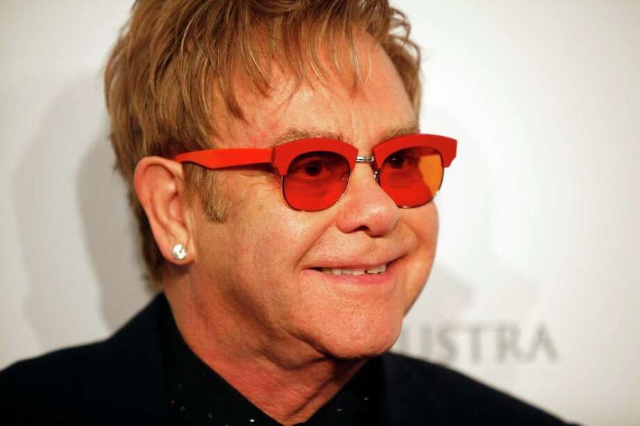 "FILE - In this Oct. 15, 2013 file photo, Elton John arrives at the Elton John AIDS Foundation's 12th Annual ""An Enduring Vision"" benefit gala at Cipriani Wall Street in New York. Tom Hardy will play John in a biopic titled ""Rocketman.""  Focus Features announced Hardy's casting as the iconic piano man on Wednesday, Oct. 23, 2013. (Photo by Carlo Allegri/Invision/AP, File) Photo: Carlo Allegri, Carlo Allegri/Invision/AP / Invision"