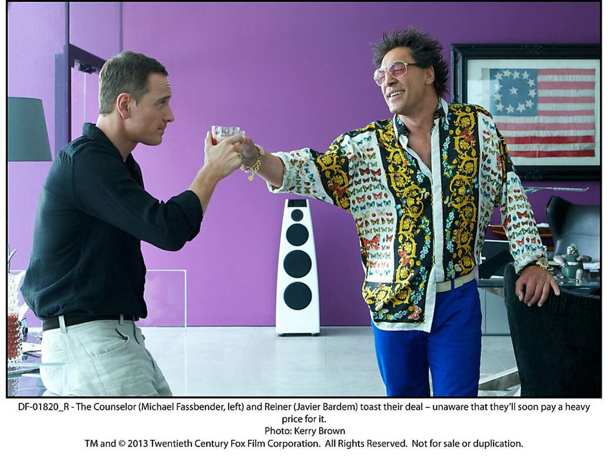 DF-01820_R - The Counselor (Michael Fassbender, left) and Reiner (Javier Bardem) toast their deal â€