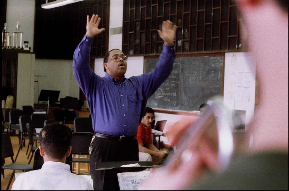 Clarence Acox directs the Garfield Jazz band in 1995. The school's jazz director for decades, Acox has been a driving force in the band's many awards and accolades.  Photo: GRANT M. HALLER, P-I File