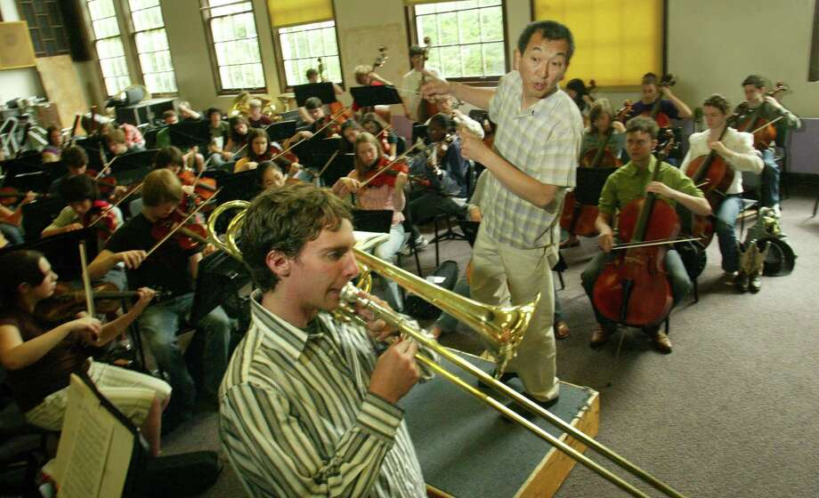 Garfield, 2006: Marcus Tsutakawa directs the Garfield High School orchestra, including trombonist Ross Humgate-Hawk. Tsutakawa was honored for his years of dedication to public school music that year.  Photo: Karen Ducey, P-I File