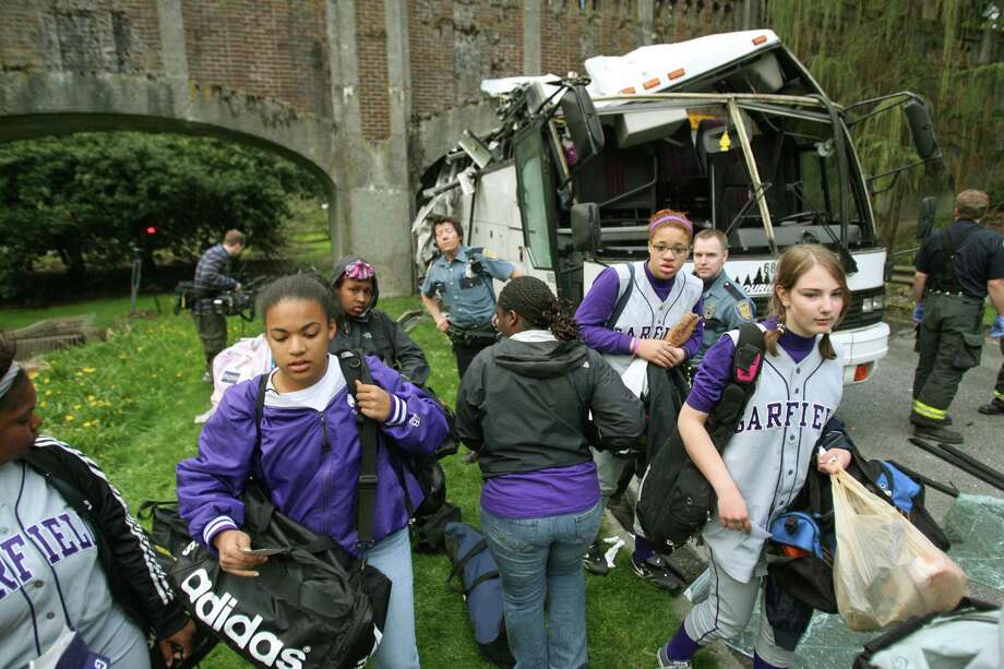 A tour bus carrying Garfield High School softball players crashed into a pedestrian bridge on Lake Washington Blvd. in the Washington Park Arboretum on April 16, 2008.  Photo: Dan DeLong, P-I File / Seattle Post-Intelligencer