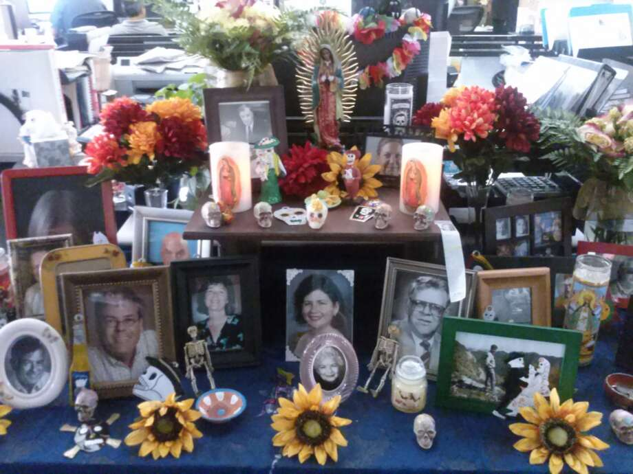 The San Antonio Express-News puts together an altar for Dia de los Muertos honoring colleagues who have died in recent years. The altar includes, photosgraphs of those who have died, sugar skulls, candles and flowers. Closer to Dia de los Muertos, food such as pan de muerte and pan dulce will be added to the offerings.