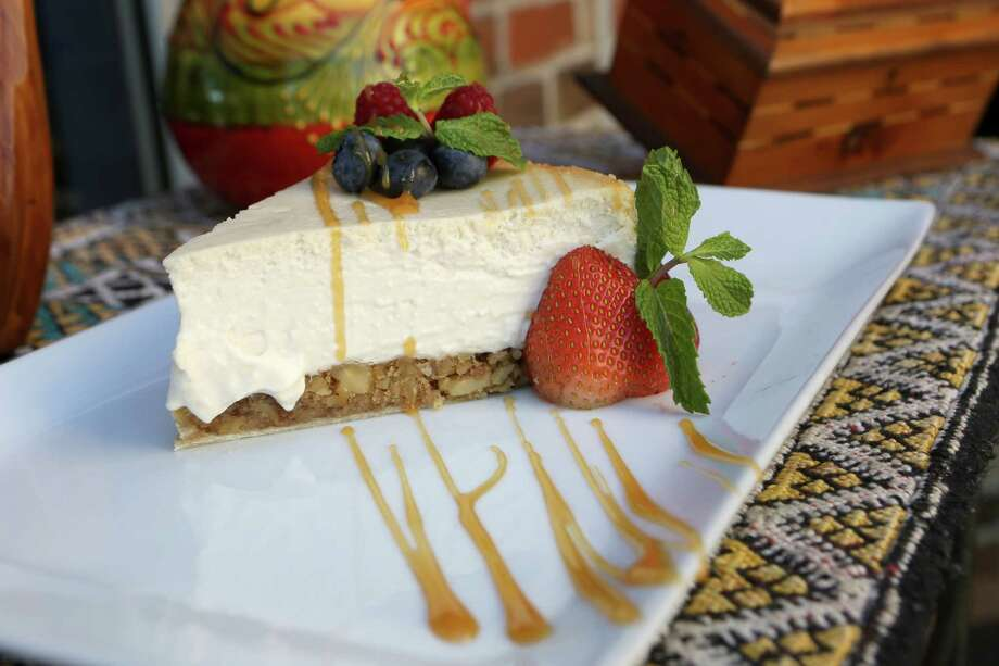 "What: Azro baklava cheesecake, 2211 NW Military Highway, Suite 131, 210-342-0011, www.azro-bistro.comWhat makes it a treat: Moroccan chef Khalid Said combined two of his favorite desserts: baklava and cheesecake. ""It's our best seller,"" he said. We have to admit we were a little skeptical at first, but we nearly licked the plate clean. Layers of pistachio and honey cheesecake filling are sandwiched between phyllo sheets. What's not to love?Cost: $7.99 Photo: Helen L. Montoya, San Antonio Express-News / ©2013 San Antonio Express-News"