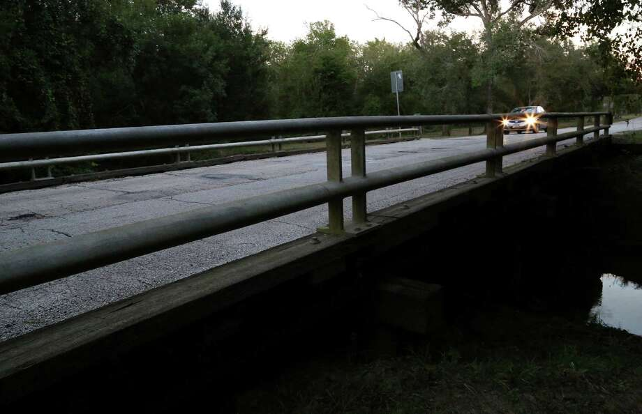 According to local legend, people who park on the Patterson bridge near Eldridge hear tapping noises on their cars. Photo: Karen Warren, Staff / © 2013 Houston Chronicle