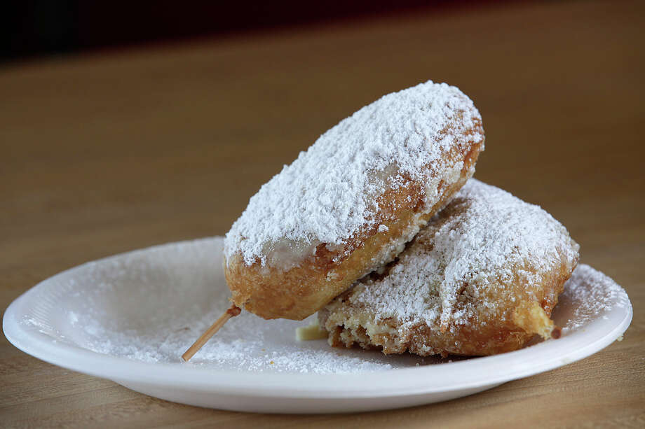 What: Deep Fried Twinkie, Big Bob's Burger's, 447 W. Hildebrand Ave., Suite 105, 210-734-2627, www.bigbobsbur gers.comWhat makes it a treat: Doubt the popularity of a Twinkie? When Hostess pulled the plug on the cream-filled cakes last year, cries of protest were heard 'round the world. Now picture that same classic Twinkie battered up, dropped in hot oil and deep-fried. The creamy interior gets even creamier and the outer cake gets a crispy crust; a generous sprinkling of powdered sugar adds the final touch.Cost: $1.99 Photo: JERRY LARA, San Antonio Express-News / SAN ANTONIO EXPRESS-NEWS