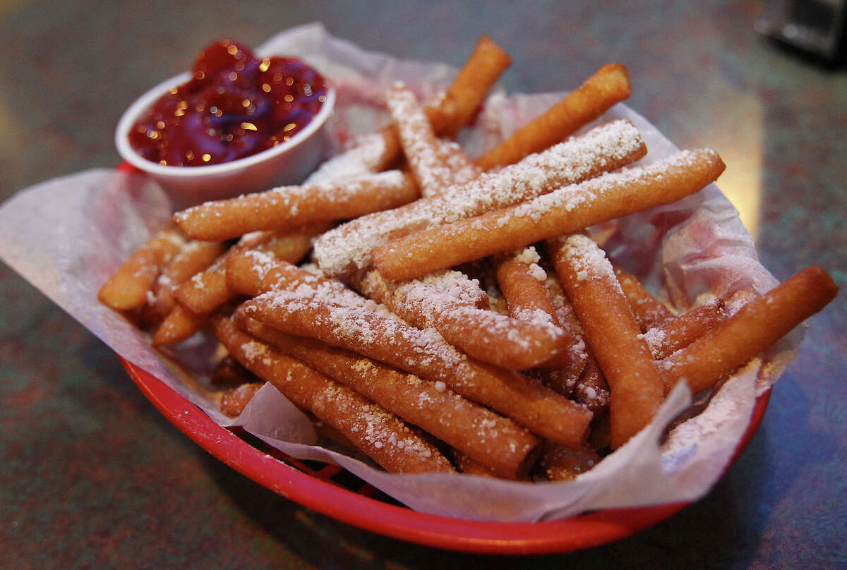 What: Funnel Cake Fries, Maars Pizza & More, 14218 Nacogdoches Road, 210-599-7400, www.maarspizzaand more.comWhat makes it a treat: Anybody who's ever had a funnel cake at a rodeo or Fiesta event knows just how good fried dough can be. Now, Maars lets you enjoy this embarrassingly good treat year around. Served in strips, similar to french fries, these funnel fries are topped with powdered sugar and can be served with strawberry topping or chocolate syrup, if desired.Cost: $5.49; add 89 cents for strawberry topping or 50 cents for chocolate syrup