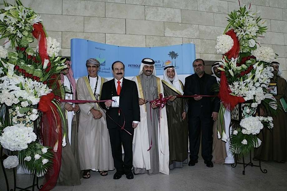 Qatar Minister of Energy and Industry Mohammed Bin Saleh Al-Sada (center) cuts a ribbon to mark the beginning of the 20th World Petroleum Congress in Doha Qatar on December 4, 2011. Photo: World Petroleum Congress