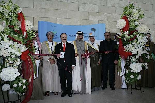 Qatar Minister of Energy and Industry Mohammed Bin Saleh Al-Sada (center) cuts a ribbon to mark the beginning of the 20th World Petroleum Congress in Doha Qatar on December 4, 2011.