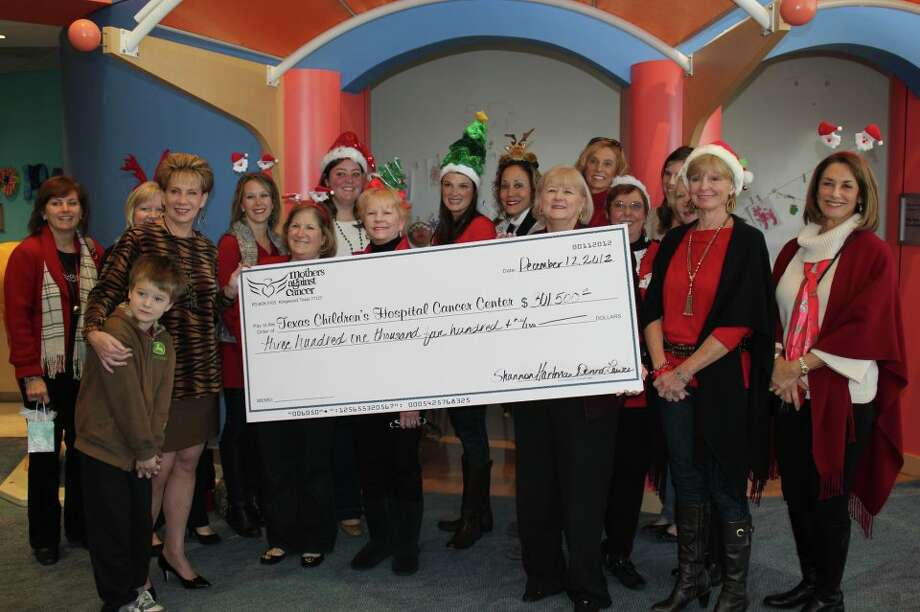 Mothers Against Cancer Executive Director Donna Lewis (front row, third from far right) holds the organization's 2012 donation to the Texas Children's Cancer Center.