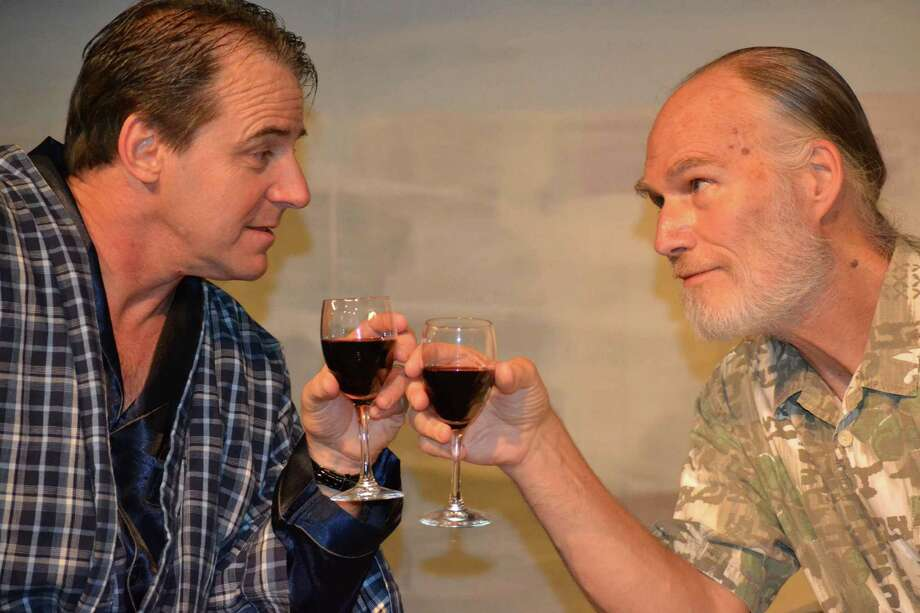 Gerardo (Kevin Daugherty) and Robert (John Stevens) toast the new democratic government. Photo: Provided By Theatre Southwest
