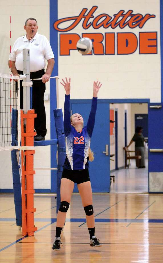Danbury High Schools Molly Wakeman hits the ball during a volley ball game against Trumbull High School at Danbury on Wednesday Oct. 23, 2013. Photo: Lisa Weir / The News-Times Freelance