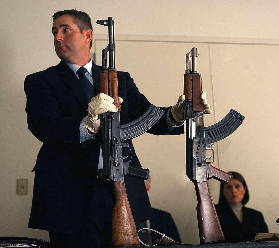 Investigator Lance Badger from the Santa Rosa police department shows an AK 47 assault style weapon (left) and Andy Lopez's toy replica gun (right) at a press conference at the community center in Santa Rosa, California, on Wednesday, October 23, 2013. Photo: Liz Hafalia, The Chronicle