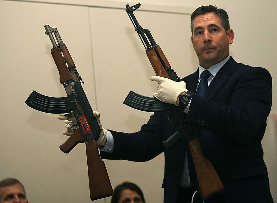 Investigator Lance Badger from the Santa Rosa police department shows Andy Lopez's toy replica gun (left) in comparison to an AK 47 assault style weapon (right) at a press conference in the community center in Santa Rosa, California, on Wednesday, October 23, 2013. Photo: Liz Hafalia, The Chronicle