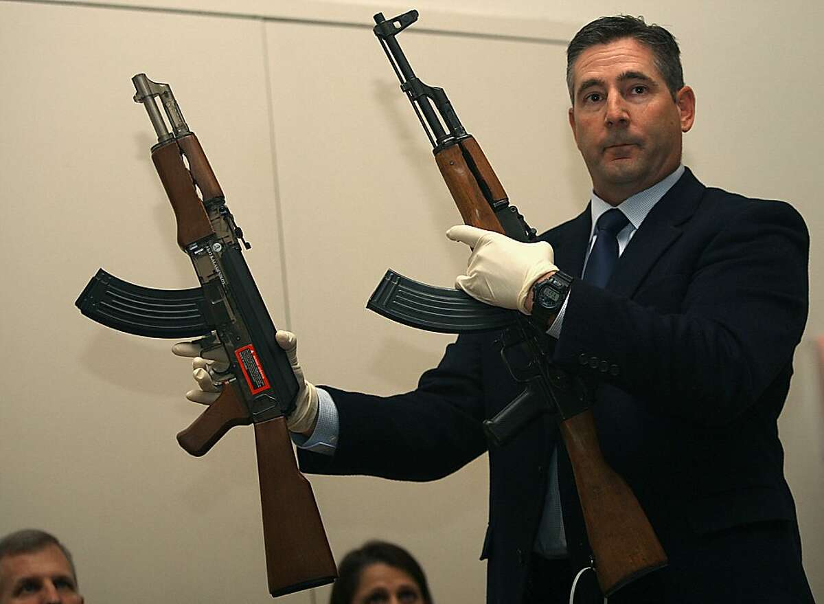 Investigator Lance Badger from the Santa Rosa police department shows Andy Lopez's toy replica gun (left) in comparison to an AK 47 assault style weapon (right) at a press conference in the community center in Santa Rosa, California, on Wednesday, October 23, 2013.