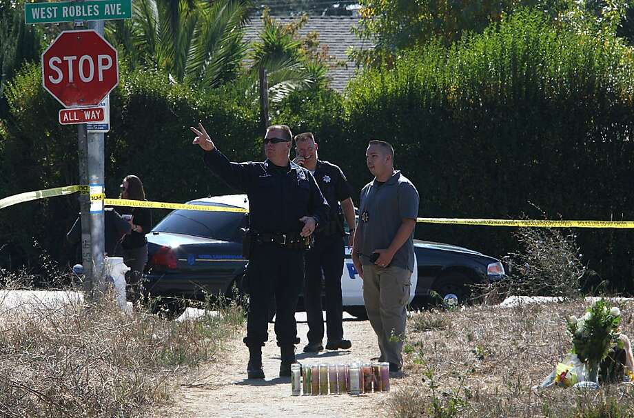 FILE — Police investigate the neighborhood where 13-year-old Andy Lopez was shot yesterday afternoon in Santa Rosa, California, on Wednesday, October 23, 2013.  Andy Lopez was shot by two Sonoma County deputies patrolling Moorland Ave. and West Robles Ave. while he was carrying toy replica guns. Photo: Liz Hafalia, The Chronicle