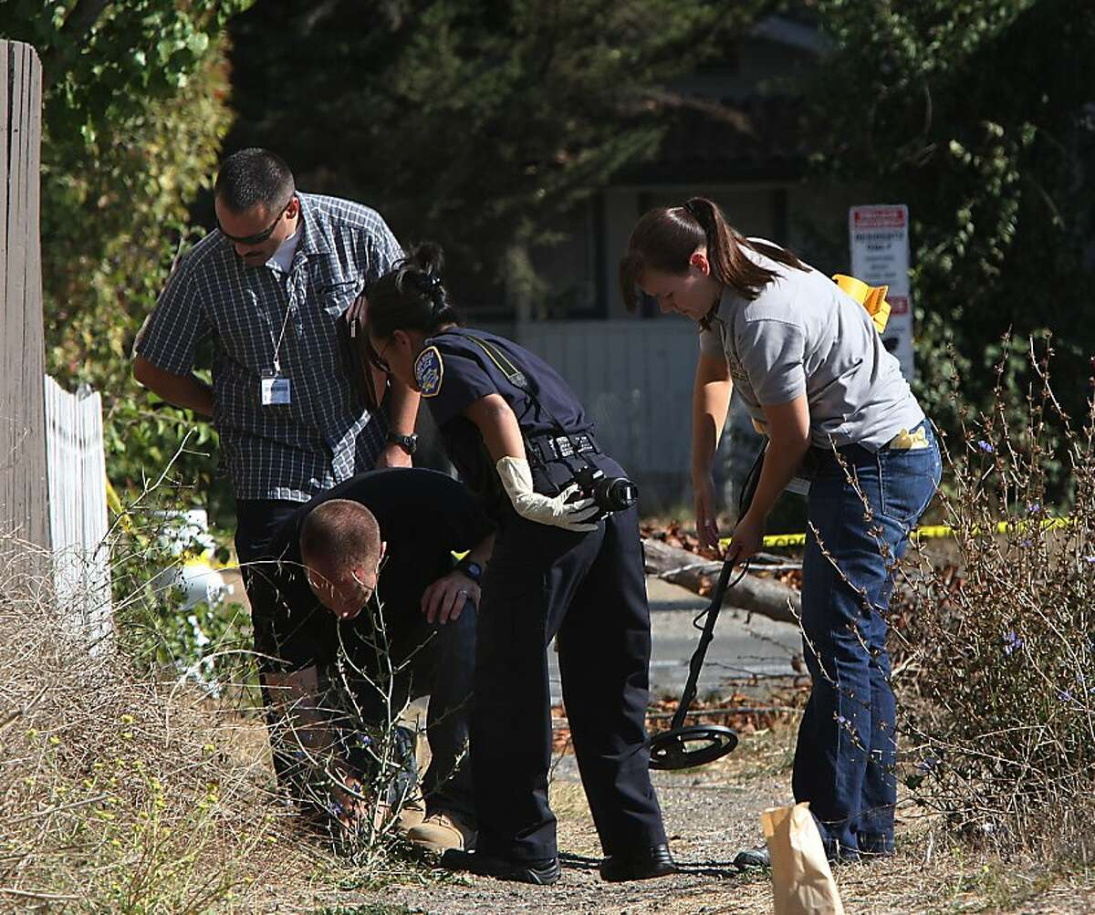 Police use a metal detector while they investigate the neighborhood where 13-year-old Andy Lopez was shot in Santa Rosa, California, on Wednesday, October 23, 2013. Andy Lopez was shot by two Sonoma County deputies patrolling Moorland Ave. and West Robles Ave. while he was carrying toy replica guns.