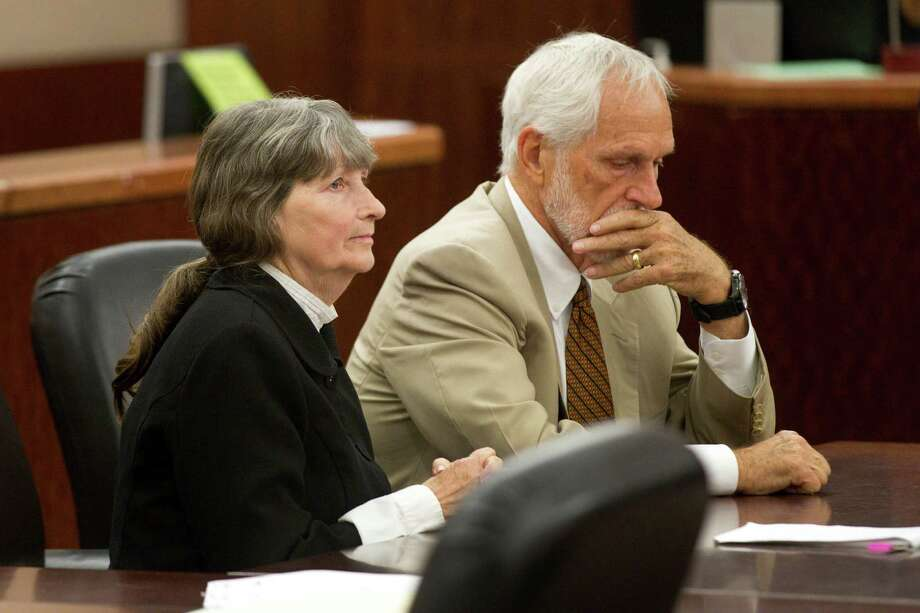 Carolyn Krizan-Wilson, with lawyer James Stafford, got six months in prison for her husband's murder. Photo: Brett Coomer, Staff / © 2013 Houston Chronicle