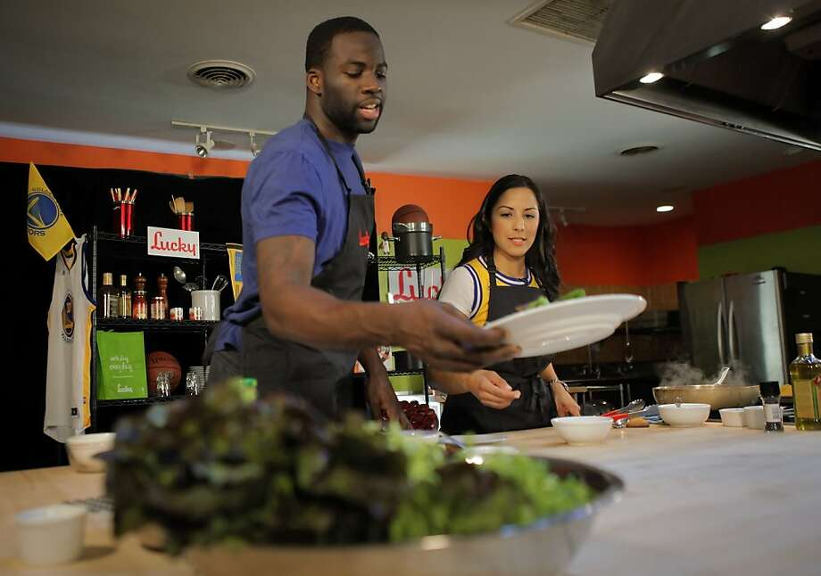 "Draymond Green gathers ingredients to cook tacos with Ruby Lopez during a video shoot for ""Eat Like Warriors."" Photo: Carlos Avila Gonzalez, The Chronicle"