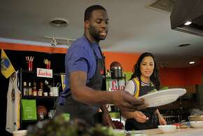 "Draymond Green gathers ingredients to cook tacos with Ruby Lopez during a video shoot for, ""Eat Like A Warrior,""  Lucky Supermarkets campaign at Fire in the Kitchen in Berkeley, Calif, on Monday, October 21, 2013. Draymond Green of the Golden State Warriors spent the offseason getting in better shape by taking a bigger part in his diet and learning to cook to get the most of his meals."