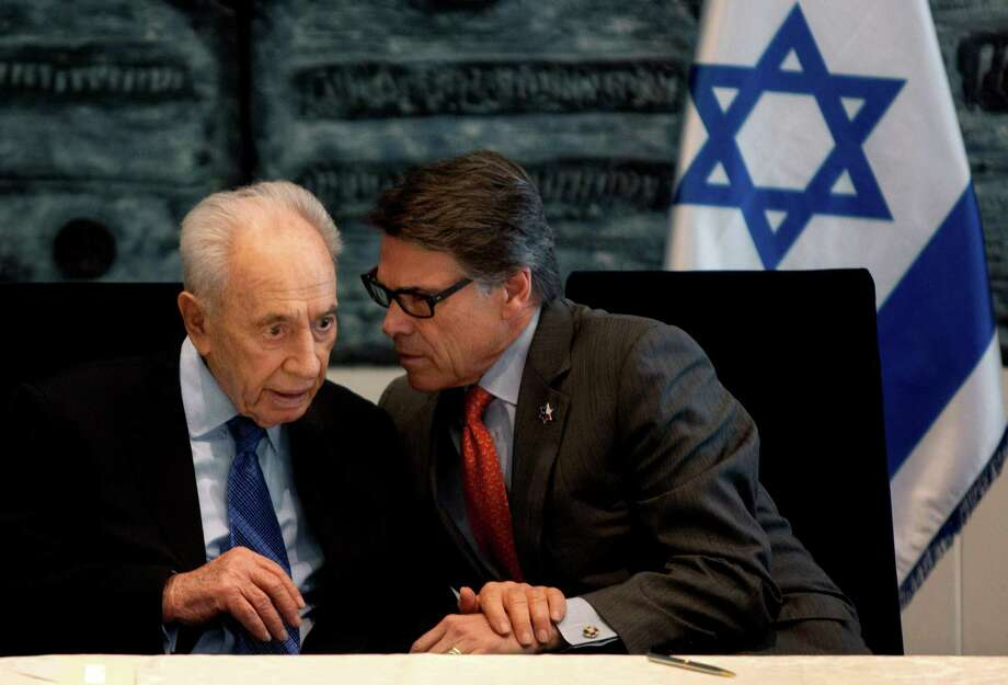 Israel's President Shimon Peres, left, and Texas Gov. Rick Perry, speak during a ceremony in the President's residence in Jerusalem, Wednesday, Oct. 23, 2013. Texas A&M University said it plans on opening a branch campus in Israel, a first-of-its-kind project that will expand the American university's growing overseas presence. (AP Photo/Sebastian Scheiner) Photo: Sebastian Scheiner, Associated Press / AP
