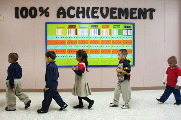 HISD wants to focus on younger students, like these at Robinson Elementary, before they fall too far behind.