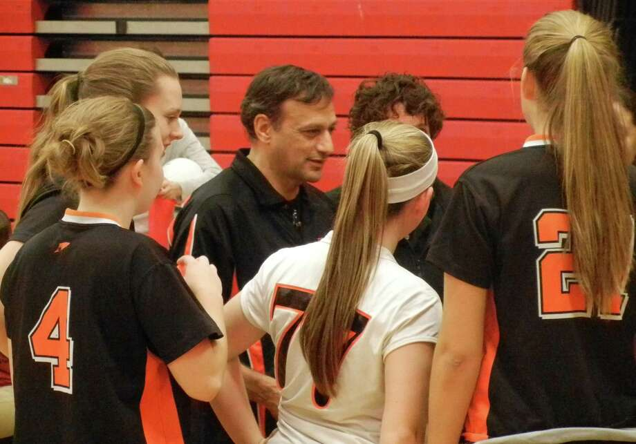 Stamford coach Mike Smeriglio talks to his team between games on Wednesday, Oct. 23 in Fairfield. The Knights beat Warde 3-1 in an FCIAC girls volleyball match. Photo: Reid L. Walmark / Fairfield Citizen