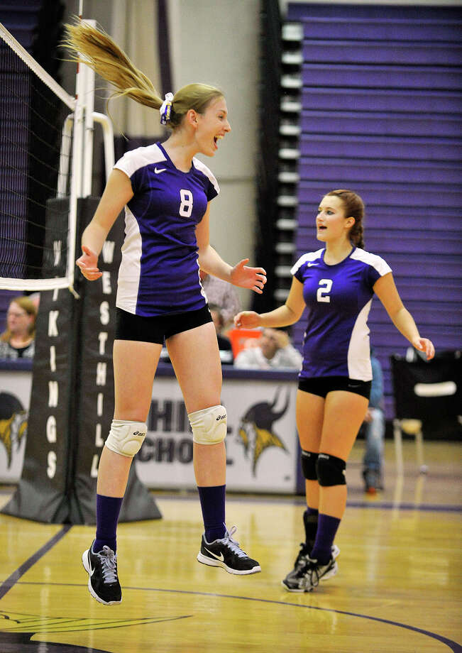 Westhill's Hannah Douherty leaps in jubilation after the final point of the match where Westhill defeated Trinity Catholic, 3-0 at Westhill High School in Stamford, Conn., on Wednesday, Oct. 23, 2013. Photo: Jason Rearick / Stamford Advocate