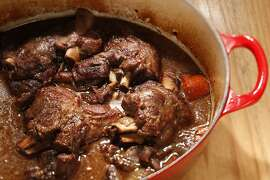 Lamb shanks braised in red wine as seen in San Francisco, California, on Wednesday October 16, 2013. Food styled by Lynne Bennett.