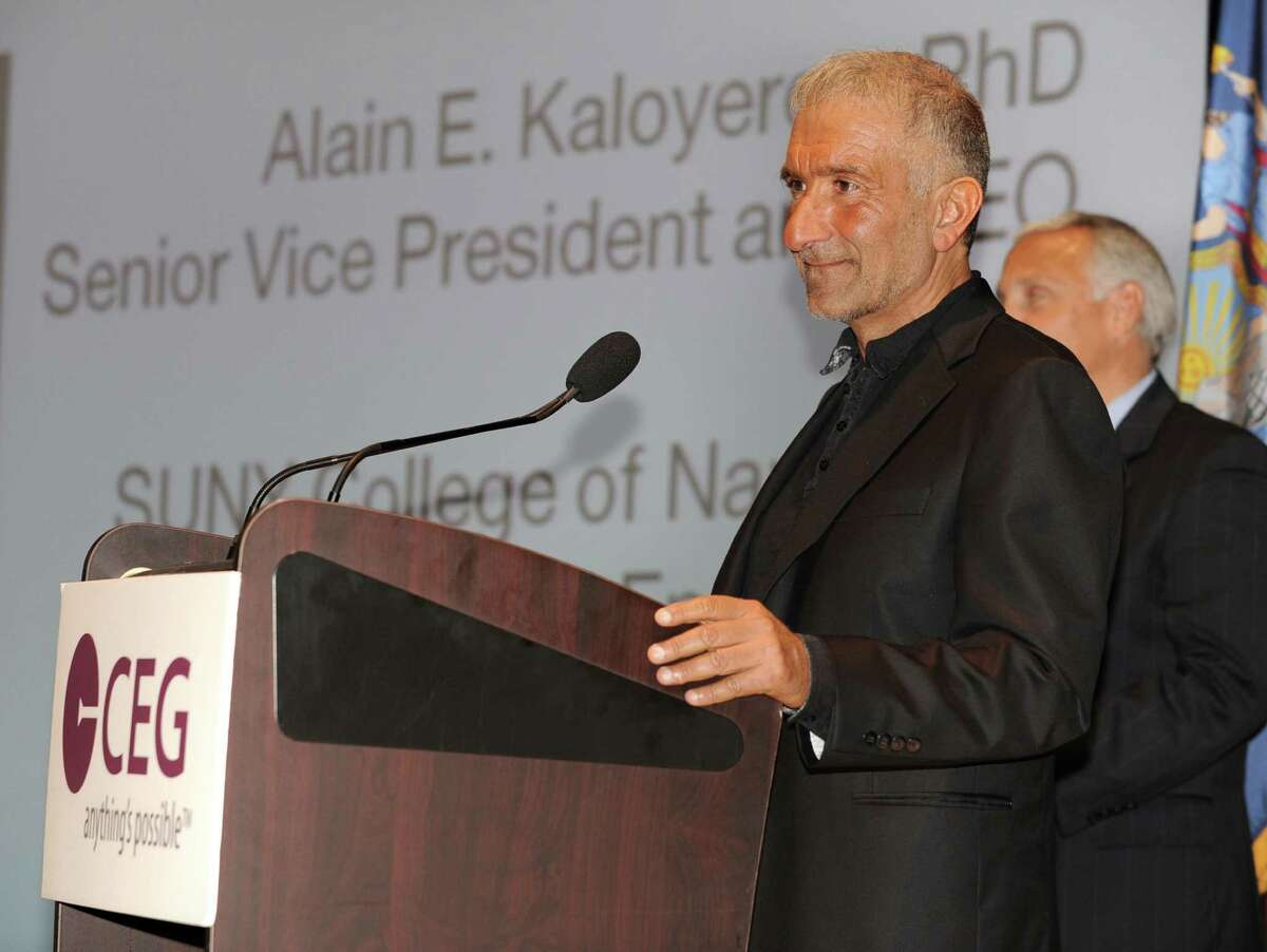 Alain Kaloyeros, Senior Vice President and Chief Executive Officer for CNSE at University At Albany, delivers the keynote speech at the annual meeting of the Center for Economic Growth at Kiernan Plaza on Wednesday, Oct. 23, 2013 in Albany, N.Y. CNSE Vice President for Marketing and Communications Steve Janack listens in the background. (Lori Van Buren / Times Union)