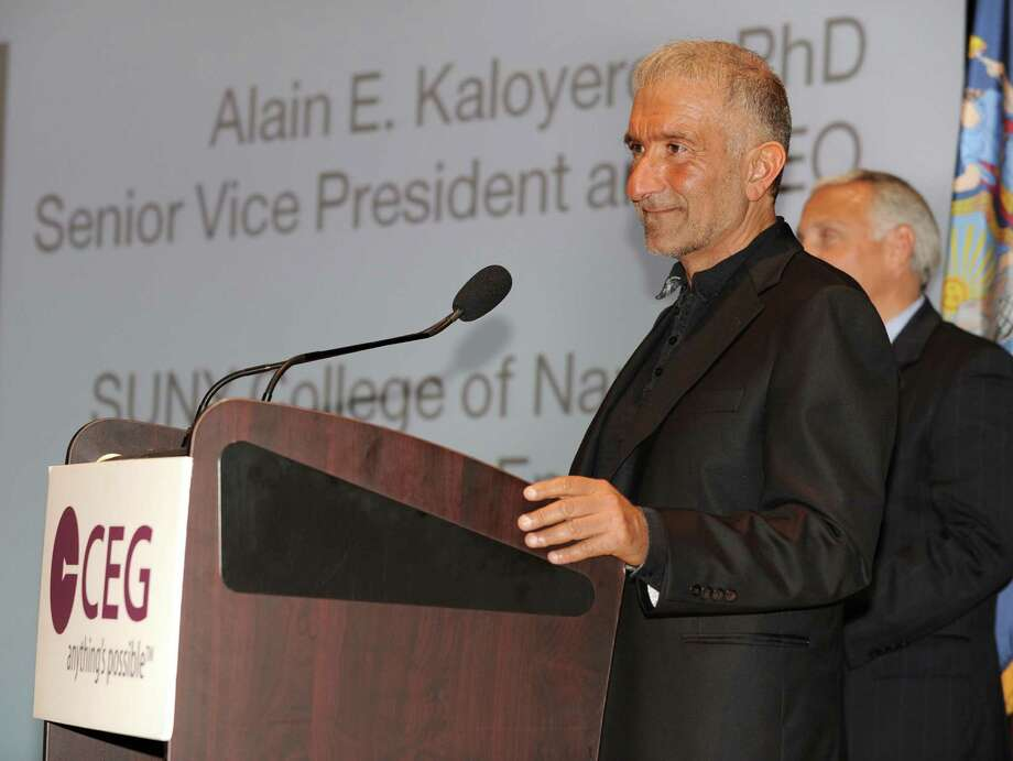 Alain Kaloyeros, Senior Vice President and Chief Executive Officer for CNSE at University At Albany, delivers the keynote speech at the annual meeting of the Center for Economic Growth at Kiernan Plaza on Wednesday, Oct. 23, 2013 in Albany, N.Y. CNSE Vice President for Marketing and Communications Steve Janack listens in the background.  (Lori Van Buren / Times Union) Photo: Lori Van Buren / 00024366A