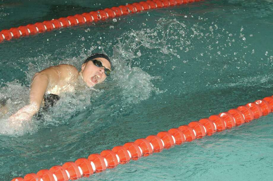 New Canaan's Kate Colwell races in the 100 yard freestyle event. Colwell came in second in a time of 54.75. By Andy Hutchison Photo: Contributed Photo / New Canaan News