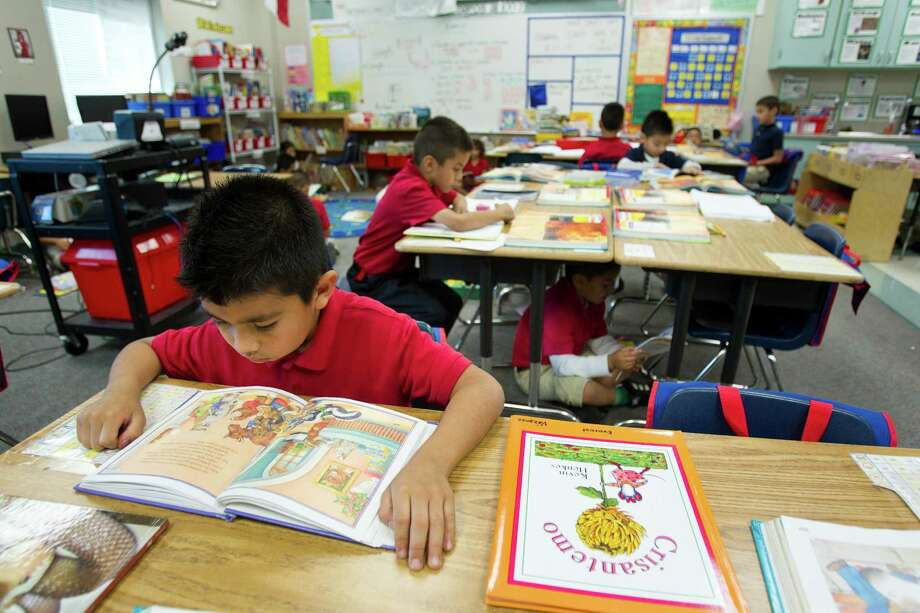 Jose Manuel Hernandez reads during Sustained Silent Reading at Robinson Elementary School Wednesday, Oct. 23, 2013, in Houston. A new study shows elementary schools in the Apollo program had the biggest gains, with the results better in math than in reading. The program includes small group tutoring in math. Photo: Brett Coomer, Houston Chronicle / © 2013 Houston Chronicle