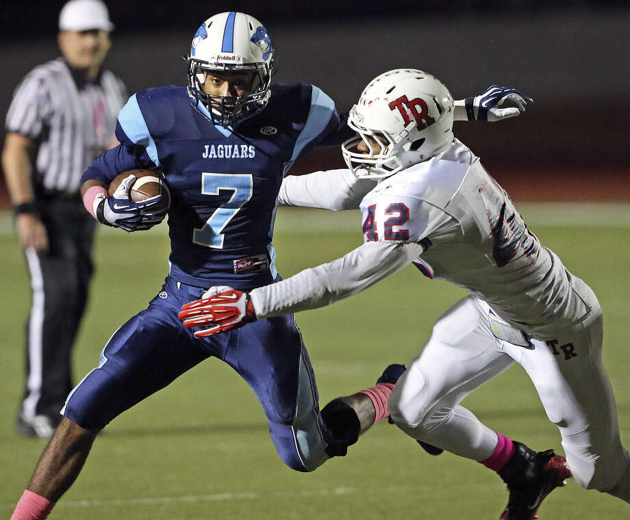 Darion McElhannon, trying to elude Roosevelt's John Taylor, leads Johnson in rushing. Photo: Tom Reel / San Antonio Express-News