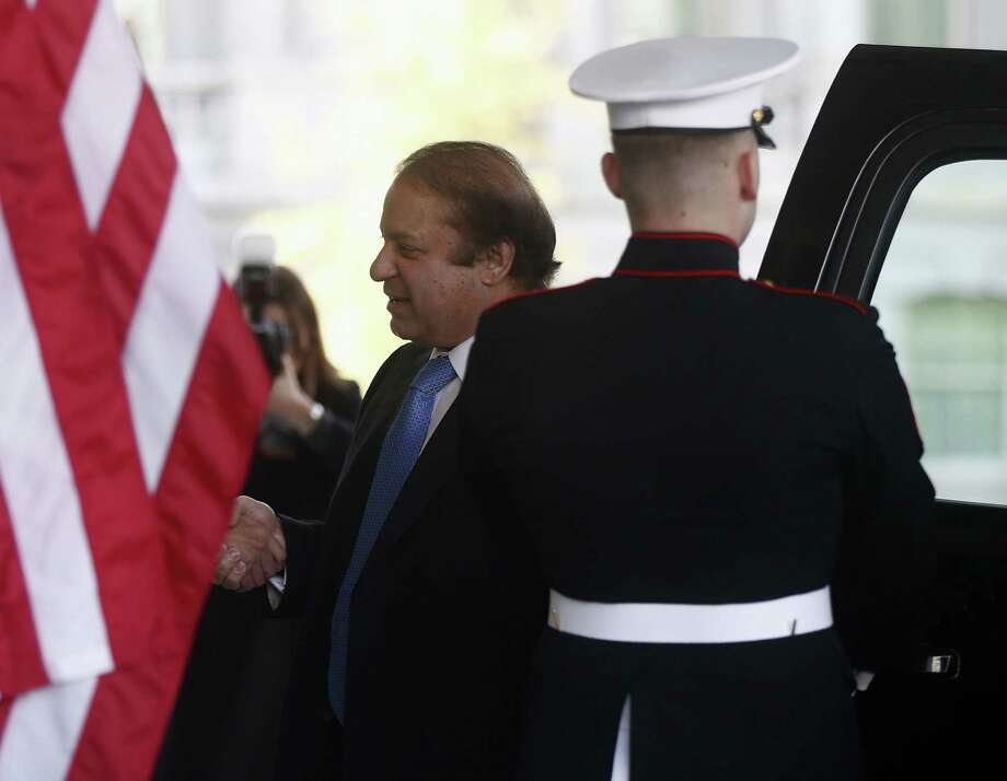 """Pakistani Prime Minister Nawaz Sharif, arriving at the White House, said this week that CIA drone strikes in his nation's tribal region """"have deeply disturbed and agitated our people."""" Photo: Charles Dharapak / Associated Press"""